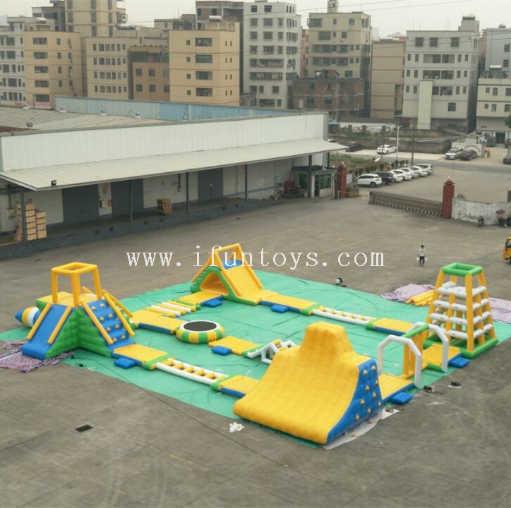 Cheap Inflatable rapids aquapark lake water floating obstacle course park factory for kids and adults